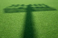 Shadow of stadium light on the grass Royalty Free Stock Photo