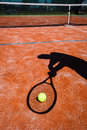 Shadow of a tennis player in action Royalty Free Stock Photography