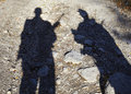 Shadow of two armed men