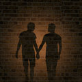 Shadow of two men on the wall Royalty Free Stock Photo