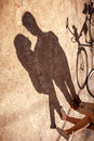The shadows on the alley in the park of lovely couple standing n near bicycle Royalty Free Stock Photography