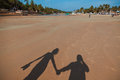Shadows on the beach of two persons Royalty Free Stock Images