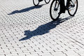 Shadows of cyclists Royalty Free Stock Image