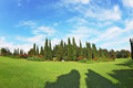 The shadows of the cypresses most romantic landscape park garden in italy slender gently fall on green meadows Royalty Free Stock Photo