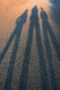 Shadows ending in the blurs long from three persons Royalty Free Stock Photos