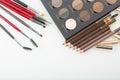 Shadows eye and eyebrow set on table pencils Stock Photo