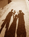 Shadows of three people Royalty Free Stock Photography