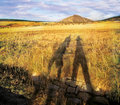 Shadows under hill of two figures sunset in czech mountains Stock Images