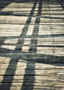 Shadows on a wooden board bridge Royalty Free Stock Photo