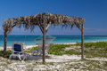 Shady hut by the ocean peaceful cottage on beach with sea view in cuba Stock Images