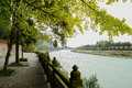 Shady riverside footway with lichen covered balustrade in cloudy stone afternoon dujiangyan china Royalty Free Stock Image