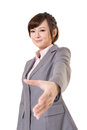 Shake hand young business woman with you closeup portrait isolated on white background Stock Photos