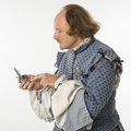 Shakespeare using cell phone. Royalty Free Stock Images