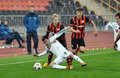Shakhtar player knocks his opponent to the ground photo was taken during match between u vs bayer u uefa youth league group stage Royalty Free Stock Image