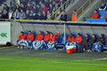 Shakhtar players hiding blankets with symbols of the team dnepr blue smoke in stands fans during match between dnepropetrovsk city Stock Photography