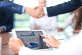 Shaking hands business associates in office Stock Photography