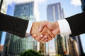 Shaking hands two in corporate attire Stock Images