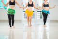 Shaking hips belly dancers their while performing in the dance hall Stock Photos