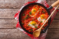 Shakshuka breakfast of fried eggs and tomatoes in a pan. horizon Royalty Free Stock Photo