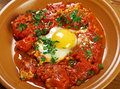 Shakshuka dish of eggs poached in a sauce of tomatoes chili peppers and onions often spiced with cumin moroccan tunisian libyan Stock Photography