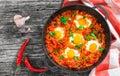 Shakshuka - fried eggs, onion, bell pepper, tomatoes, chili Royalty Free Stock Photo