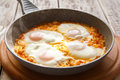 Shakshuka - traditional dish of israeli cuisine in a skillet Royalty Free Stock Photo