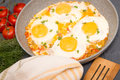 Shakshuka - traditional dish of israeli cuisine in a skillet pan Royalty Free Stock Photo