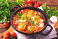Shakshuka. Traditional Israeli cuisine. Fried eggs with vegetabl Royalty Free Stock Photo