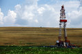 Shale gas drilling rig color shot of a on a field Stock Image