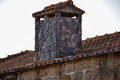 Shale house chimney on an roof Stock Images