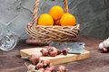 Shallots onion garlic chopping board knife orange with basket on the table Royalty Free Stock Photo