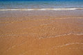 Shallow of sea on sand beach gold Stock Photos