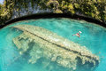 Shallow shipwreck a lies in water in palau s inner lagoon which is surrounded by limestone islands palau is known for its Stock Photography