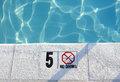 Shallow water in pool close up of a swimming with a no diving warning Royalty Free Stock Photography