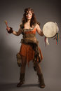 Shaman woman with a tambourine in studio portrait of Stock Photo