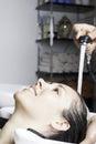 In the shampoo basin closeup of woman sitting enjoying Stock Images