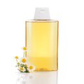 Shampoo with camomile gentle hair chamomille and flowers isolated on white background highlights and illuminates blonde hair Royalty Free Stock Images