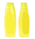 Shampoo containers isolated two closed yellow plastic on white background Stock Images