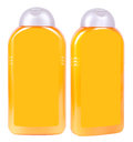 Shampoo containers isolated two yellow plastic with grey caps on white background Royalty Free Stock Photos