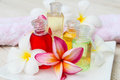 Shampoo and gel bath bottles with towels flower on white background Royalty Free Stock Images