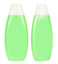 Shampoo light green containers isolated two closed plastic with white caps on white background Stock Photos