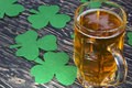 Shamrock clover and beer -symbol of St Patrick's Day Royalty Free Stock Photo