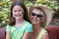Shamrock face painting candid portrait of grandmother and granddaughter at saint patrick s day wearing traditional green and Royalty Free Stock Images