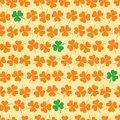 Shamrock seamless vector pattern in green, orange and yellow