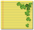 Shamrock on yellow note paper Royalty Free Stock Photos