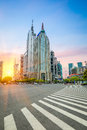 Shanghai century avenue in sunset with sidewalk zebra crossing Royalty Free Stock Photos
