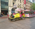 Shanghai china okt locomotive to transport tourists nanjing road is the main shopping street of and is one of the world s Stock Photos