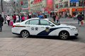 Shanghai police car parked at kerbside china february a a busy intersection near people s square pedestrians can be Royalty Free Stock Photography