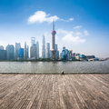 Shanghai skyline in daytime with wooden floor background Stock Images