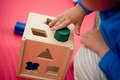 Shape sorter toddler playing with wooden Stock Photos